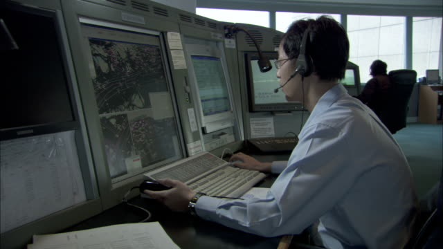 A shipping lane controller monitors several displays.