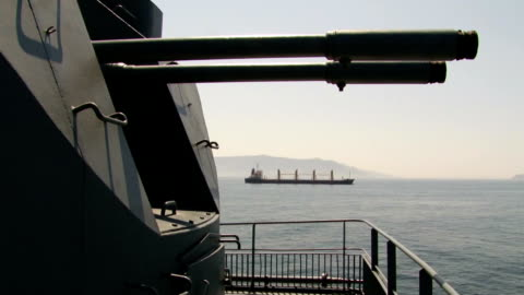 shipping under the protection of guns of warships - warship stock videos & royalty-free footage