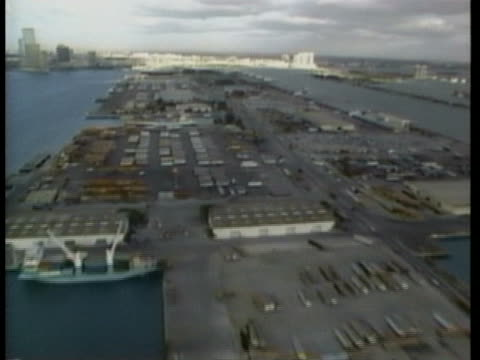 stockvideo's en b-roll-footage met ships and cargo containers fill a harbor. - sport