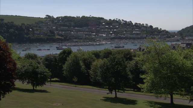 Ships are anchored in the River Dart behind Britannia Royal Naval College.