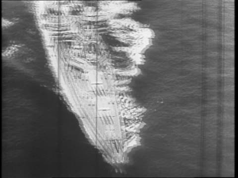 ships at sea / ship under construction / crowd of shipyard workers / scaffolding around ship workers in yard / men enlisting near sign that says... - william halsey stock-videos und b-roll-filmmaterial