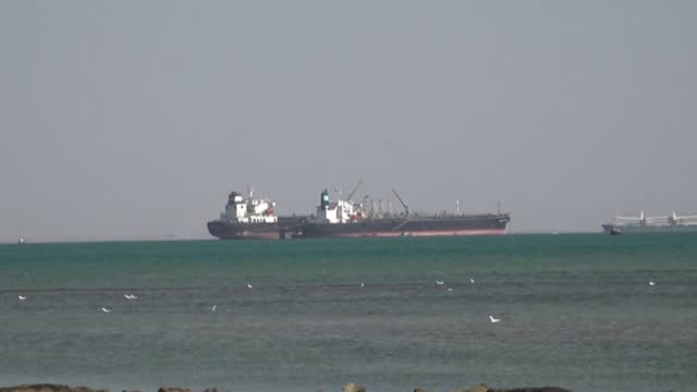 ships await the reopening of traffic in the suez canal as the mv ever given was refloated, sparking relief almost a week after the huge container... - suezkanalen bildbanksvideor och videomaterial från bakom kulisserna