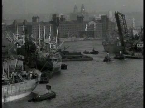 ships boats in english harbor ws british dock workers unloading supplies crates from ships in dock ms male officer w/ eagle insignia/patch on... - unloading stock videos & royalty-free footage