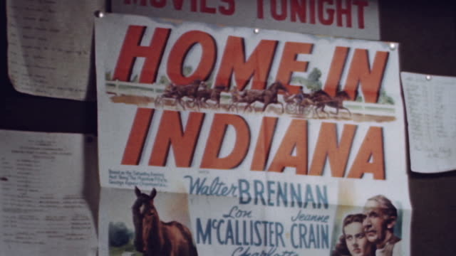 ms ship's bulletin board featuring movie poster of home in indiana during wwii - bulletin board stock videos and b-roll footage