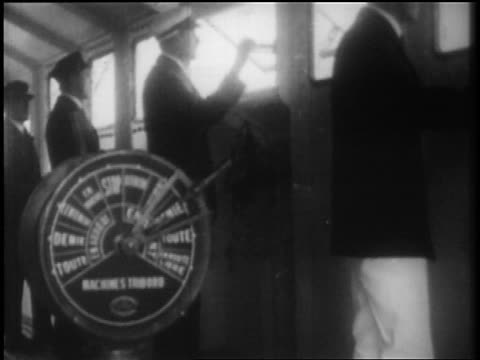 b/w 1928 ship's captain + crew looking out window on bridge / newsreel - 1928 stock videos & royalty-free footage