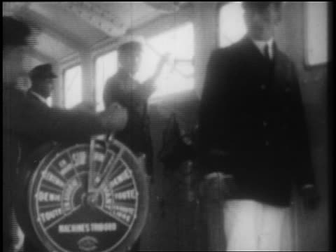 b/w 1928 ship's captain + crew on ship's bridge / newsreel - 1928 stock videos & royalty-free footage