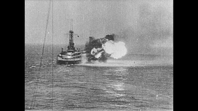 vídeos y material grabado en eventos de stock de 1923 ship's captain orders crew to fire on numbered targets in the ocean - 1923