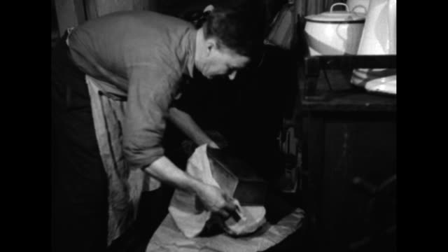 ship's cook takes pan of probably bread out of oven turns it over and lifts it off loaf / ms cook flipping pancakes on griddle big and smaller... - effie stock videos and b-roll footage