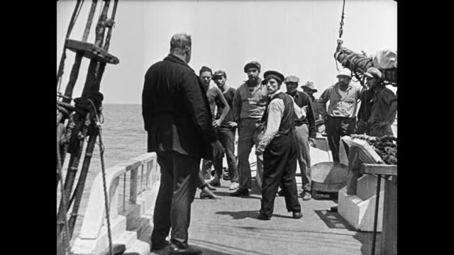 1923 ship's crew scatter after irate captain (joe roberts) climbs back on deck and chases cabin boy (buster keaton) who tried to take over his position - 1923 stock videos & royalty-free footage