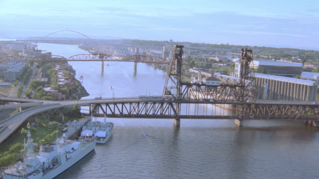 ships dock in a river near three bridges. - portland oregon stock videos & royalty-free footage