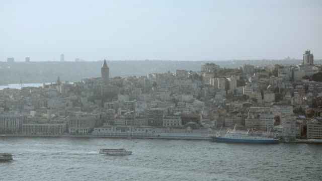 aerial ships docked in the harbor of congested oceanfront city / istanbul, turkey - turkey stock videos and b-roll footage