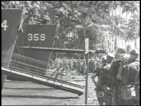ship's gangplanks, down, lowering, new zealand soldiers, 'kiwis', some in camouflage uniforms, walking off ships onto shore w/ tall palm trees &... - pacific islands stock videos & royalty-free footage