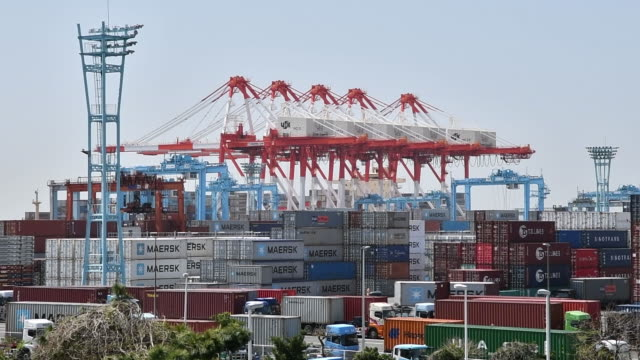 Ships gantry cranes and containers at a shipping terminal in Yokohama Japan on Monday April 16 2018