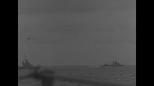 MS ship's guns firing in water off Indonesia / MS US Navy ships / VS ship's guns firing ships at sea / MS guns rotating on deck of US battleship / MS...
