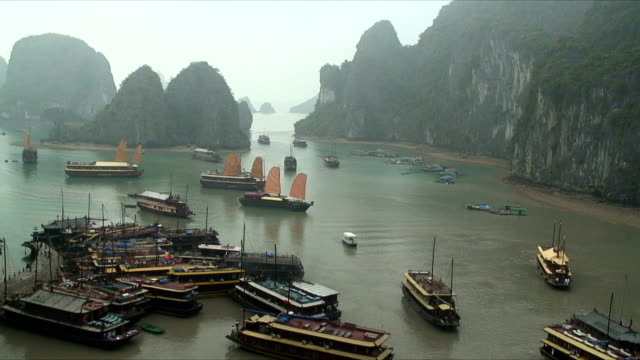 ws ha ships in cove, halong bay, vietnam - halong bay stock videos and b-roll footage