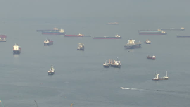 ws pan ships in singapore strait / singapore - straits stock videos and b-roll footage