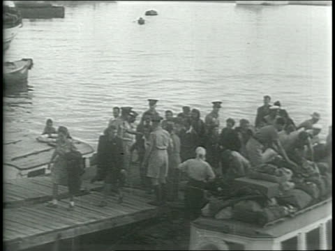ships in the bay at haifa / jewish refugees depart from boat / jewish refugees board busses / narrated - haifa video stock e b–roll