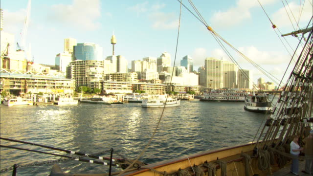 Ships moor in Sydney Harbor.