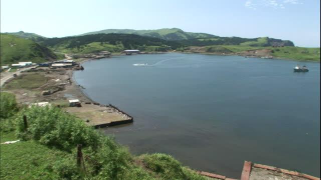 Ships moor in the Shakotan Port on Shikotan Island.