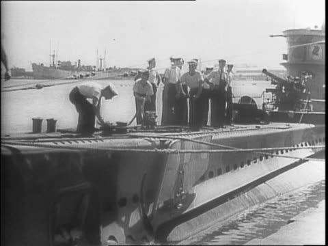 ships moving through water / montage of of general dwight d eisenhower and admiral andrew cunningham on a ship deck / shot of a submarine on surface... - 船の一部点の映像素材/bロール