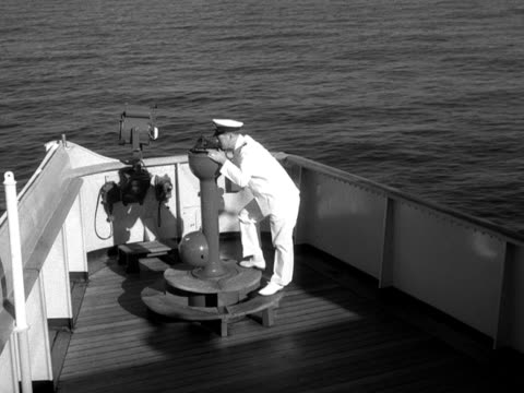 a ships officer looks through a sextant - sextant stock videos & royalty-free footage