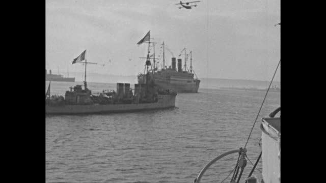 ships on water probably near cherbourg harbor smaller one bears us and french flags - normandie stock-videos und b-roll-filmmaterial