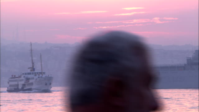 ships pass each other under a dramatic pink sky. - cargo ship stock videos & royalty-free footage