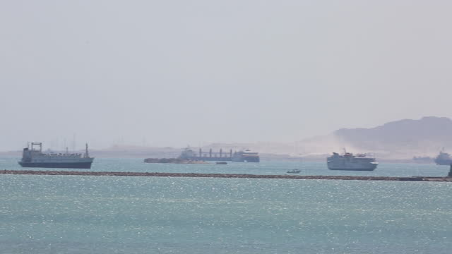 ships wait to cross the suez canal on sunday, march 28, 2021 in suez, egypt. the container ship, ever given, ran aground and has been blocking... - suez canal stock videos & royalty-free footage