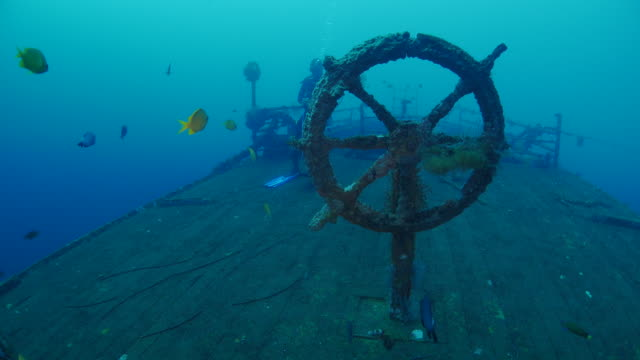 ship's wheel of the boga shipwreck, kubu (northern bali) (4k) - man made object stock videos & royalty-free footage