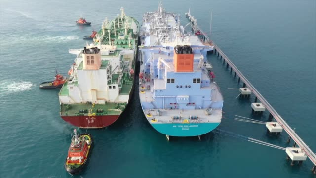 ship-to-ship lng transfer is conducted between qatar's al sadd lng carrier and turkish company botas' floating storage regasification unit at a port... - gas stock videos & royalty-free footage