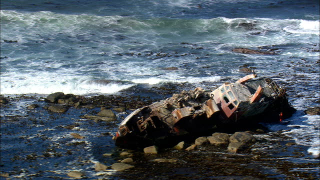 shipwreck in hondeklipbaai harbour  - aerial view - northern cape,  south africa - stranded stock videos and b-roll footage