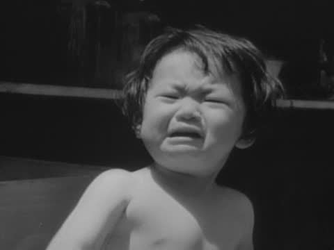 vídeos de stock, filmes e b-roll de shipwreck of uss oglala/ civilians suffering the japanese air raid - air raid