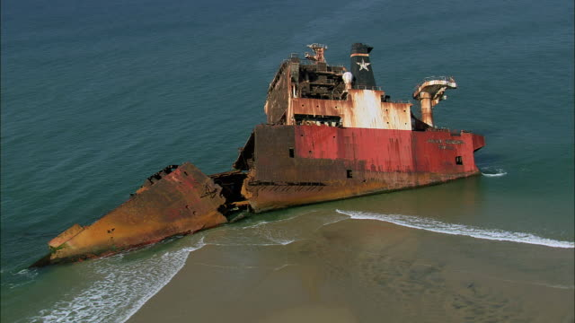 aerial ws shipwreck on beach, st lucia park, kwazulu natal, south africa - st lucia stock videos & royalty-free footage