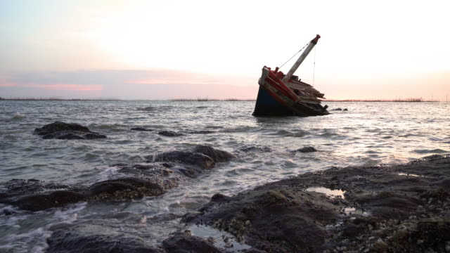 shipwreck on the beach. - sink stock videos and b-roll footage