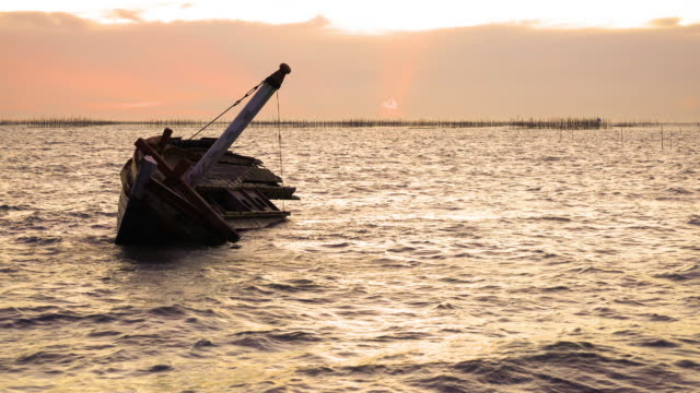 shipwreck on the beach. - fishing village stock videos and b-roll footage