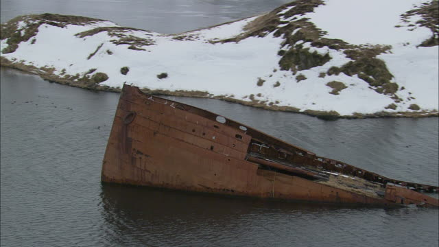 a shipwreck sticks out of alaska's dutch harbor. - shipwreck stock videos & royalty-free footage