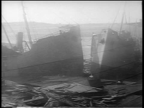 b/w 1938 shipwrecked boats after hurricane / new london connecticut / newsreel - new london county connecticut stock videos & royalty-free footage