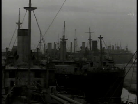 shipyard filled w/ scrap ships ship w/ 'condemned' on side. vs ships docked idle. weathered sign on rotting merchant ship 'triumph' - shipyard stock videos & royalty-free footage