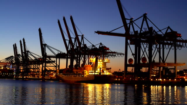shipyard in hamburg at sunset, time lapse - hamburg germany stock videos & royalty-free footage
