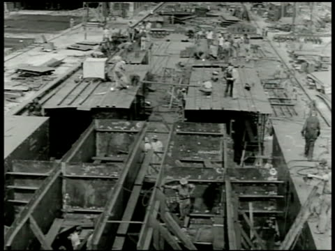 vidéos et rushes de shipyard, vs men working on ship deck. male welder welding. wwii, world war ii. - 1942