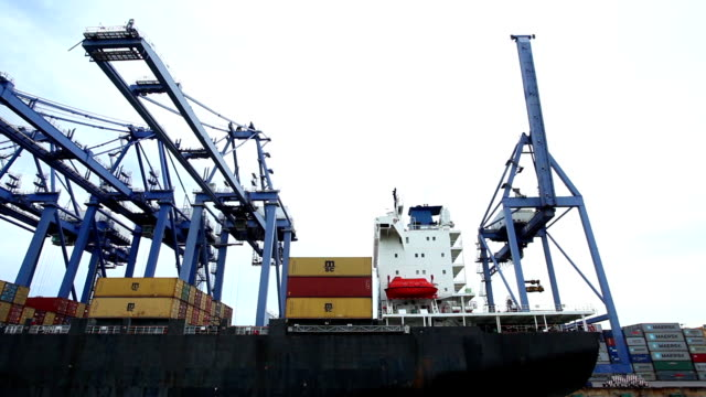 Shipyard working loading container cargo freight ship at sea
