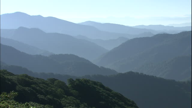 shirakami mountains silhouetted in front of bright sky, akita, aomori, japan - real time stock videos & royalty-free footage