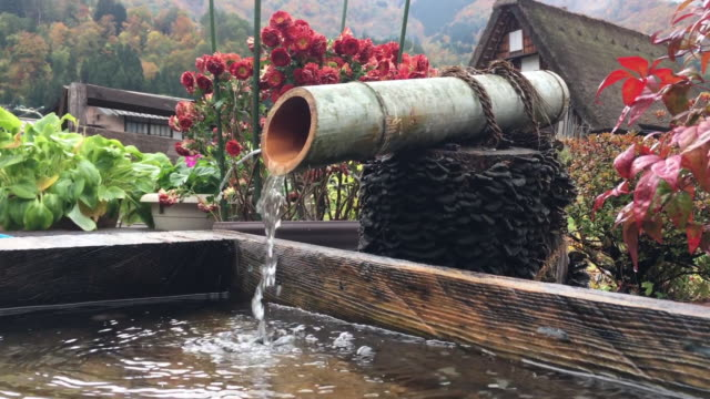 shirakawago village, decorative fountain japanese style and house gifu prefecture, japan - fire hose stock videos & royalty-free footage