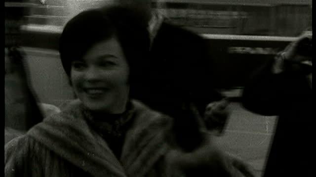 vídeos de stock e filmes b-roll de shirley temple dies aged 85 lib london heathrow airport ext shirley temple along at london airport shirley temple interview sot i'll be 37 on april... - shirley temple