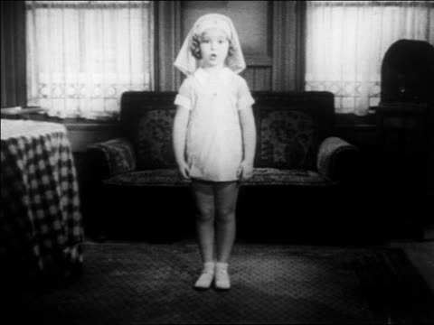 shirley temple standing in red cross uniform talking camera / newsreel - 1935 stock videos & royalty-free footage