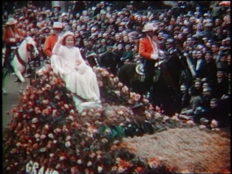 vídeos de stock e filmes b-roll de shirley temple waving from float / grand marshall of rose bowl parade / pasadena ca / newsreel - shirley temple