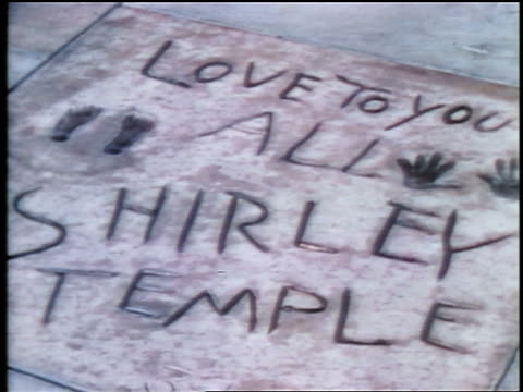 1937 Shirley Temple's handprints in sidewalk in front of Grauman's Theatre / Hollywood / feature