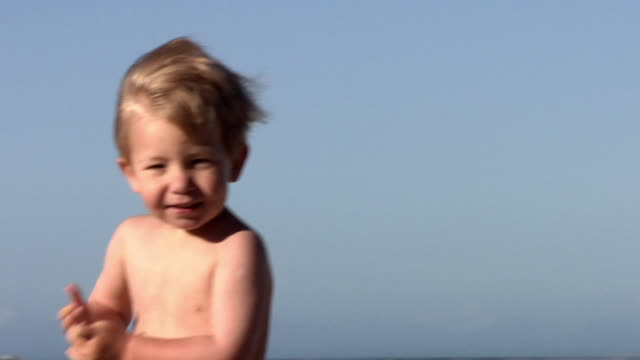 slo mo cu pan shirtless boy (2-3) playing on beach, cape town, south africa - only boys stock videos and b-roll footage