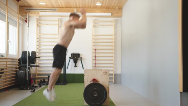 shirtless man doing a box jump in the gym - shirtless stock videos & royalty-free footage