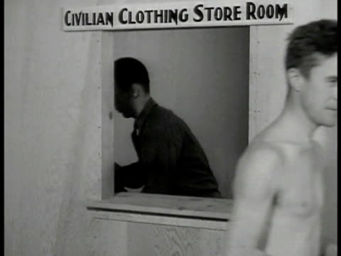 shirtless men turning in clothes to man behind booth recruits in line receiving army clothes two recruits trying on uniform dramatization vs recruits... - shirtless stock videos & royalty-free footage